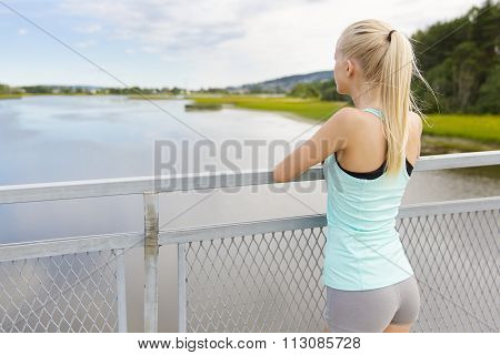 Thoughtful young woman rests after training