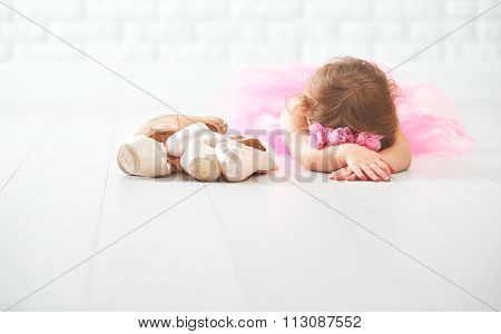 Little Child Girl   Ballerina With Ballet Shoes And Pointe Shoes