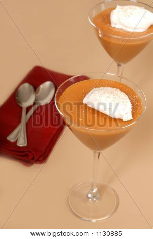 Two Butterscotch Puddings In Martini Glasses