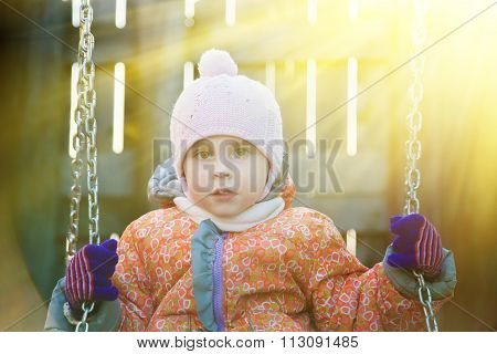 Cute kid swinging.