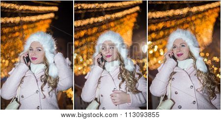 Portrait of young woman with white fur cap talking on mobile outdoor in cold winter evening