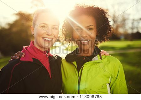 Close-up Of Two Young Sportswomen In Park