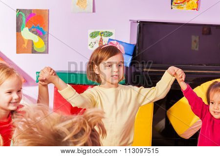 Girl roundelay  with children in kindergarten