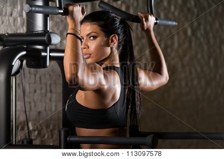 Latina Woman Doing Heavy Weight Exercise For Back