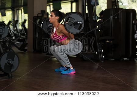 Latino Woman Doing Exercise Barbell Squat