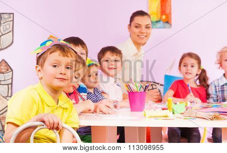 Kids on craft class with mates and teacher