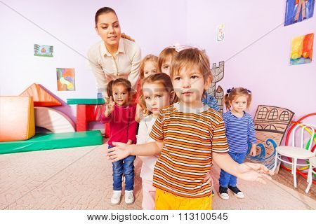 Portrait of kids group boys girls and nurse