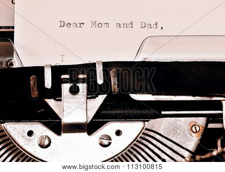 Letter with a title Dear Mom and Dad typed on old typewriter