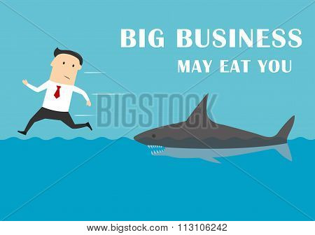 Big business shark attacking a businessman