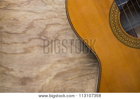 Classic Guitar On Old Wood Background