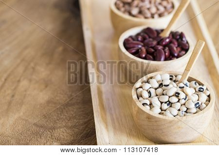 Group Of Beans On Wood Table Background