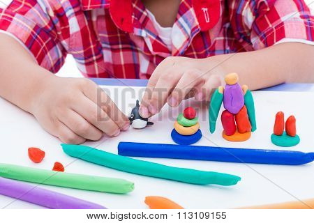 Close Up Child's Hand Moulding Modeling Clay. Strengthen The Imagination