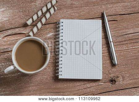 Cup Of Coffee, Biscuits And A Blank Open Notebook On A Wooden Table.top View. Free Space For Text