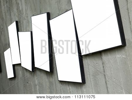 Blank Photo Frame Hanging On Cement Wall