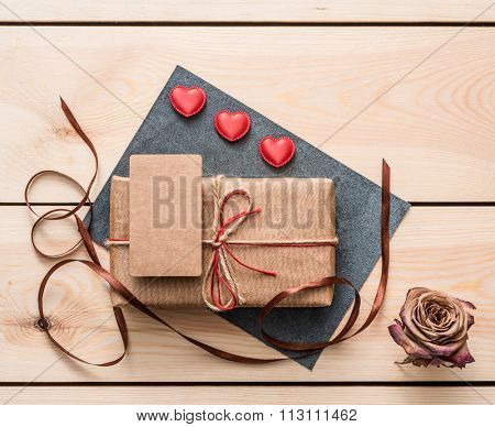 Gift box with blank tag and hearts. Top view.