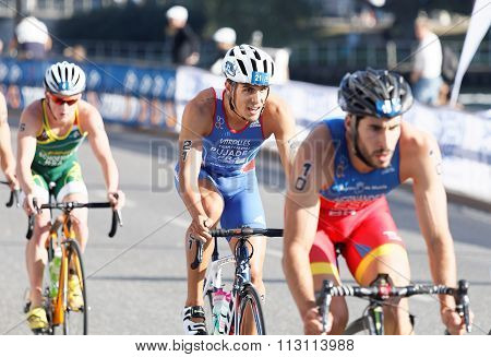 Three Colorful Triathletes Cycling