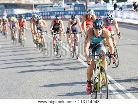 Large Group Of Colorful Triathletes Cycling