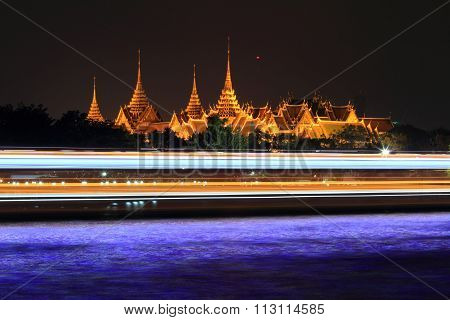 at Phra Kaew and moving light of boat passing in the river