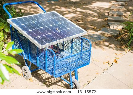 Electric Solar Cell On A Cart In The Garden