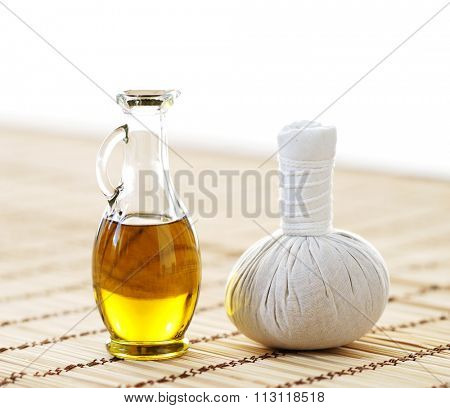 Composition of jar with spa oil and massaging ball.