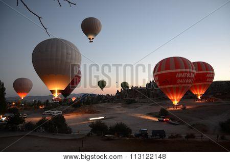 Hot-air balloons preparing for takeoff at Cappadocia Turkey