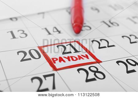 Payday concept. Calendar with red felt pen background. Date in frame, close up