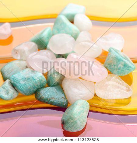 Semiprecious stones on bright background