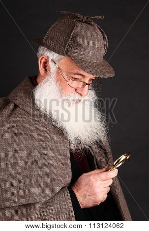 Bearded detective investigate with magnifying glass