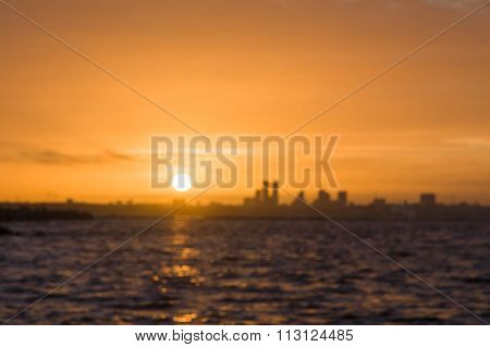 Blurred Image Of City Silhouette On Sunset