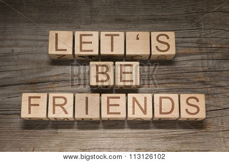 Let's be friends text on a wooden cubes