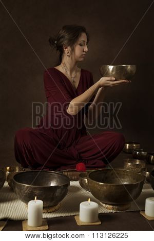 Woman With Tibetan Bowls