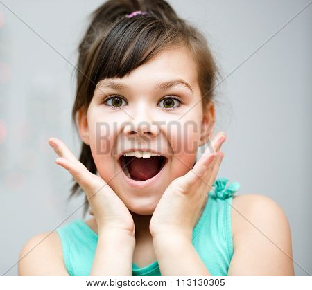Girl Is Holding Her Face In Astonishment