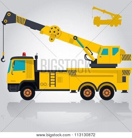 Big yellow crane with hook and arm