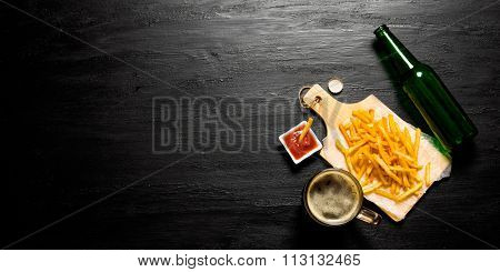 Beer And Fries With Tomato Sauce On The Chalkboard. Free Space For Text.
