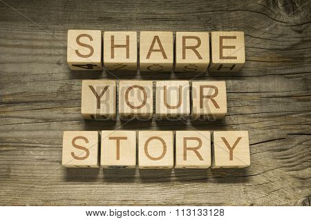 Share Your Story text on a  wooden cubes