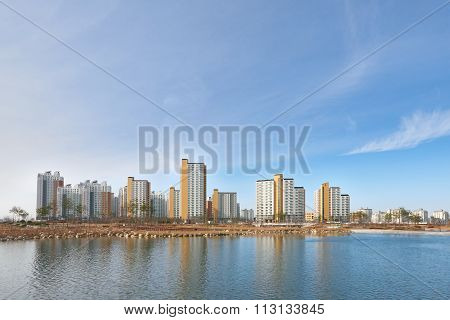 Buildings And Lake
