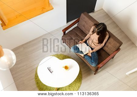 Top view of Young Woman read a novel