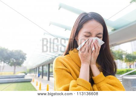 Asian Young Woman blowing nose