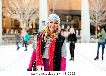 A woman at the ice rink smiles