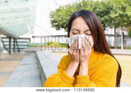 Asian Woman feeling unwell