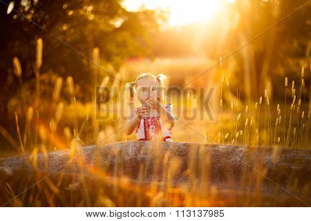 little girl playing in the sun in the outdoors