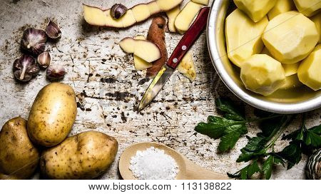The Concept Of Peeled Potatoes In A Bowl On The Rustic Background .