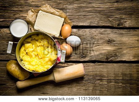 Ingredients For Mashed Potatoes - Eggs, Milk, Butter And Potatoes On Wooden Background. Free Space F
