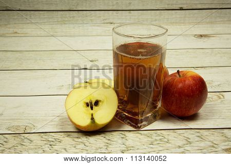 A Glass Of Apple Juice And Apples On Wooden Background Vintage