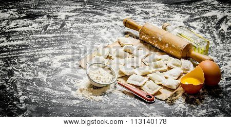 Raw Homemade Ravioli With Egg, Flour And A Rolling Pin.