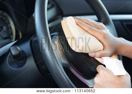 Close Up Hand Cleansing Car Dashboard