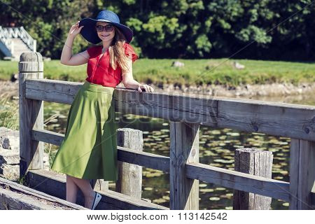 Young attractive woman standing on the bridge