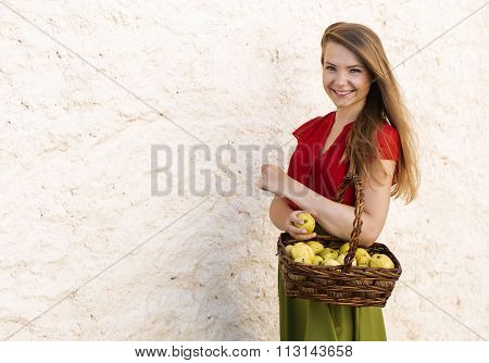 Female holds apple basket in the village