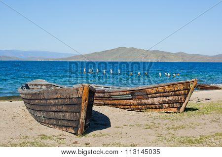 wooden boat on the sand at Lake Baikal