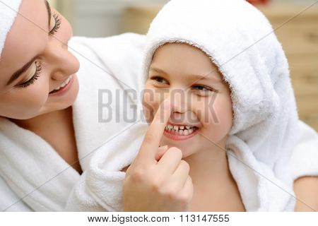 Mother and daughter in the bath room
